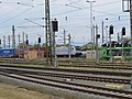 2018-06-15 (144) Railpool Class 185 672-3 and 27 80 4371 585-5 at Bahnhof St. Valentin, Austria.jpg