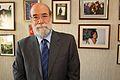 30-07-2009 Diputado Enrique Accorsi Opazo en su oficina, de pie, en primer plano. Detrás fotografías colgadas en muro..JPG
