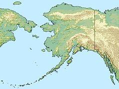"""Mapa konturowa Alaski, po prawej nieco u góry znajduje się punkt z opisem """"źródło"""", natomiast blisko centrum na prawo u góry znajduje się punkt z opisem """"ujście"""""""