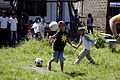 A boy at AboAbo Elementary School plays volleyball with U.S. Navy Sailors with the Health Support Service Platoon, Combat Logistics Battalion 31, 31st Marine Expeditionary Unit, at Palawan, Philippines, Oct. 24 111025-M-VG363-416.jpg