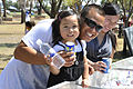 A family poses for a photo during Cannon Appreciation Day at Cannon Air Force Base, N.M., Aug. 10, 2012 120810-F-AX764-036.jpg