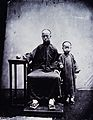 A mandarin and his son, Canton, Kwangtung province, China. Wellcome V0037104.jpg