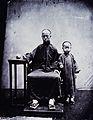 A mandarin and his son, Canton, Kwangtung province, China. Wellcome V0037104.jpg