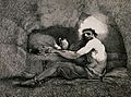 A prisoner is sitting on straw in a cave with his feet chain Wellcome V0041238.jpg