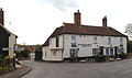 A view of the White Hart Inn from the Nags Head public house on Church Road, Moreton village, Essex, England.jpg