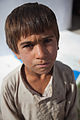 A young Afghan boy looks at the camera at the Women's Center at Forward Operating Base Pasab in Kandahar province, Afghanistan, Oct. 19, 2011 111019-A-VB845-023.jpg