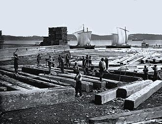 Economic history of Canada - Butting square timber, Quebec City, QC, 1872.