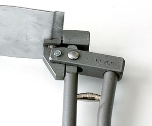 Bending (metalworking) - A joggle bend in sheet metal and a joggling tool