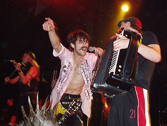 Gypsy punk - The Gypsy punk genre takes its name from Gypsy Punks, a 2005 album by Gogol Bordello, pictured here in concert in 2006.