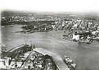 Aerial view of Sydney Harbour - the bridge is under construction.jpg