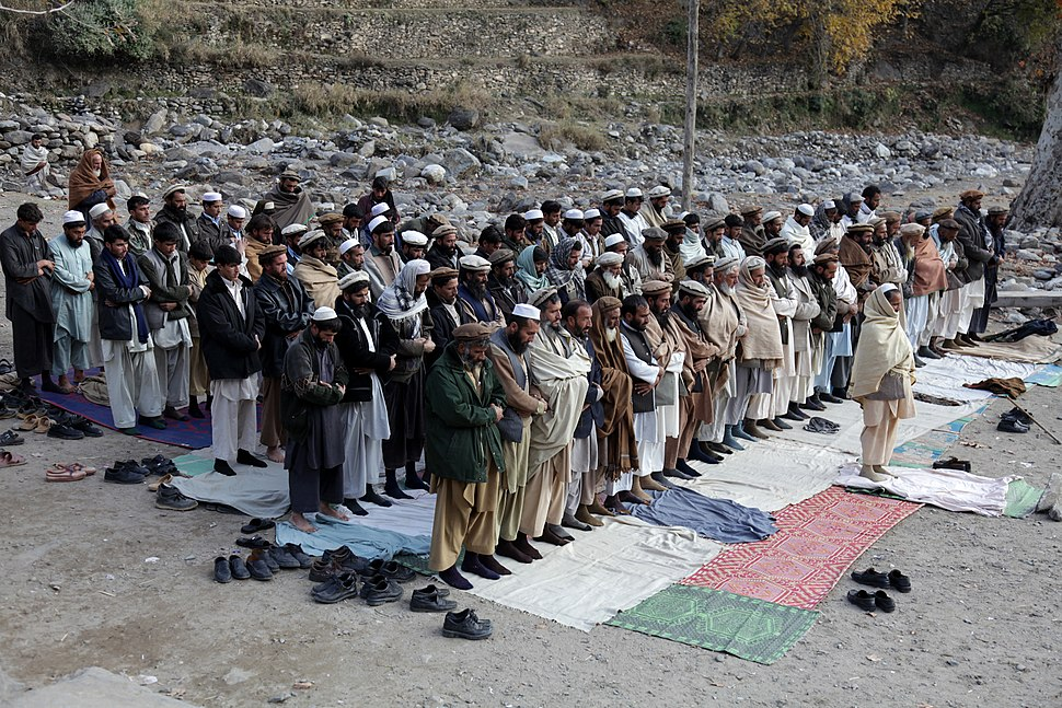 Afghan men praying in Kunar-2009