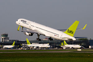 AirBaltic - An airBaltic Boeing 757−200WL takes off at Riga International Airport, the airline's base, with other aircraft in the fleet in the background (May 2010)
