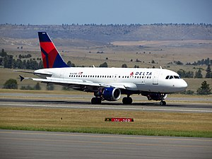 Billings Logan International Airport - A Delta Airlines Airbus A319 decelerating on the runway.