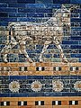 An Auroch symbol of Adad (Hadad) storm and rain god of ancient Mesopotamian religions on the Ishtar Gate of Babylon reconstructed with original bricks at the Pergamon Museum 575 BCE (3) (32577956796).jpg