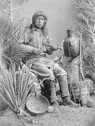 Chasi, a Warm Springs Apache musician playing the Apache fiddle, 1886 Apachefiddler.jpg