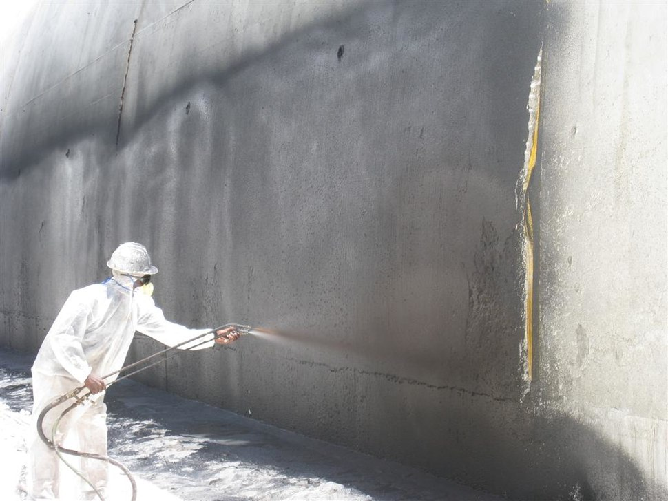 Applying waterproofing material to the outside of a tunnel.jpg