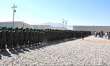 Approximately 1,350 Afghan army trainees stand in formation at the start of the Regional Basic Warrior Training course graduation ceremony at Camp Shaheen, Balkh province, Afghanistan, July 7, 2011 110707-F-IN504-011.jpg