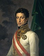 Painting shows a sober-looking curly-haired man in a white military uniform with a red and white sash and a gold collar.