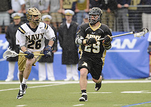 Navy Midshipmen men's lacrosse - Navy and Army players in action during the  2009 Day of Rivals.