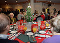 Attendees socialize during the Senior Citizens' Christmas Party at RAF Mildenhall, England, Dec. 11, 2013 131211-F-DL987-041.jpg