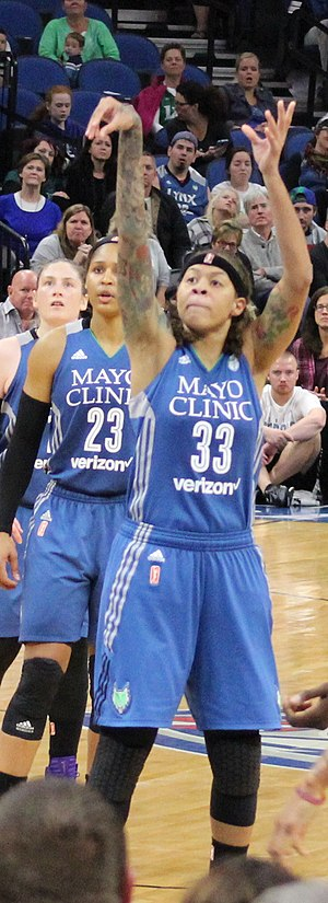 Seimone Augustus - Augustus shoots a goal in the 2016 WNBA Finals. At left are Lindsay Whalen and Maya Moore.