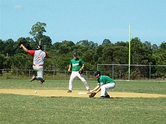 Interference (baseball) - A runner jumping over a ball to avoid an offensive interference