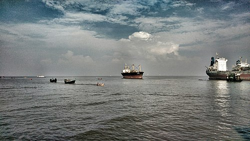 Some small fishing boats are catching fish & sell them in local coastal markets Bay of Bengal 2.jpg