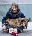 Begging man with a dog in London.jpg