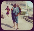 Benares - woman walking; stone steps in background LCCN2004707771.tif