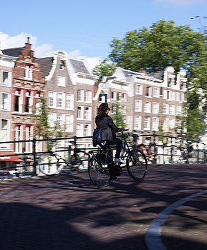 English: A bicyclist in Amsterdam, the Netherl...