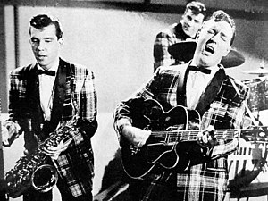 Teddy Boy - Bill Haley and the Comets wearing tartan shawl collar jackets associated with the rockabilly subculture, 1956.