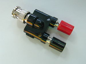 Electrical connector - A binding post (red and black) adaptor.