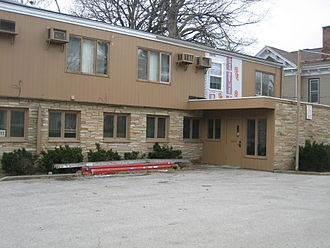 Contributing property - This medical clinic building in the East Grove Street Historic District in Bloomington, Illinois is an example of a non-contributing property.