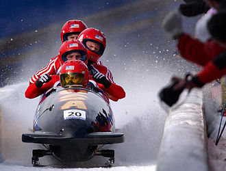 Utah Olympic Park Track - Team USA comes to a stop, finishing their third run during the 2002 Winter Olympics
