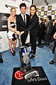 Brittany Snow, Adam Scott and Lee Toland Krieger with the LG Electronics Kompressor Vacuum on 25th Spirit Awards Blue Carpet held at Nokia Theatre L.A. Live on March 5, 2010 in LA.jpg