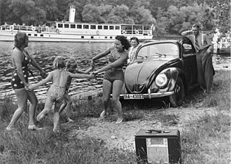 "Volkswagen Beetle -  KdF Propaganda: ""A family playing by a river with a KdF-Wagen and radio receiver"""