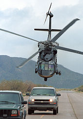 A U.S. Customs and Border Protection UH-60 Blackhawk helicopter swoops down on suspects.