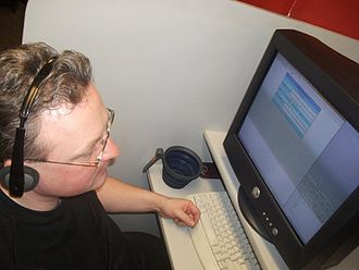 Call centre - Call centre worker confined to a small workstation/booth, using CallWeb Internet-based survey software