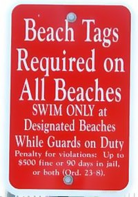 A Sign Telling Visitors That Beach Tags Are Required In Order To Use Cape May
