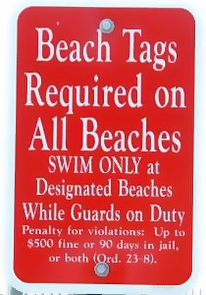 Beach tag - A sign telling visitors that beach tags are required in order to use Cape May, New Jersey's beaches.