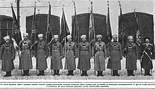 soldiers standing with flags