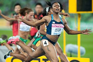 2011 World Championships in Athletics – Women's 100 metres - Carmelita Jeter winning the 100m.  In the background Shelly-Ann Fraser-Price (4th) and Ivet Lalova (7th).