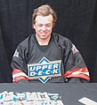 Charlie McAvoy opening hockey packs 5.jpg