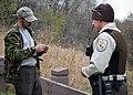Checking Hunting License (23364625171).jpg