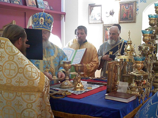 "After the transmutation of the Holy Gifts, the bishop presents to the newly ordained priest a portion of the Lamb (i.e., the Body of Christ)"" Cheirotonia Presbyter Pledge of Holy Mysteries.jpeg"