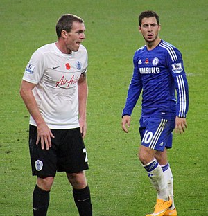 Richard Dunne - Dunne (left) marking Eden Hazard whilst playing for Queens Park Rangers.