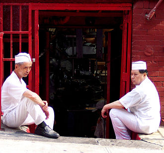 Chinatown - Cooks at a Manhattan Chinatown restaurant taking a break