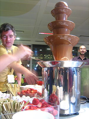 Chocolate fountain and strawberries.