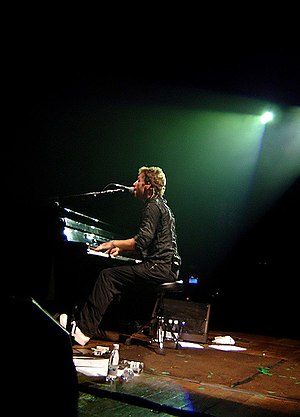"Chris Martin - Martin playing ""Trouble"" on his piano during a concert in Brazil, February 2007"