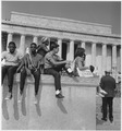 Civil Rights March on Washington, D.C. (Young men and women sitting in front of the Lincoln Memorial.) - NARA - 542048.tif